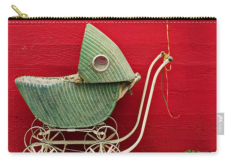 Baby Buggy Carry-all Pouch featuring the photograph Baby buggy with red wall by Garry Gay