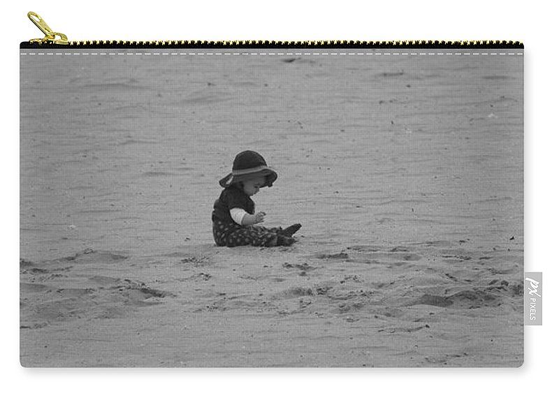 Black And White Carry-all Pouch featuring the photograph Baby In The Sand by Rob Hans