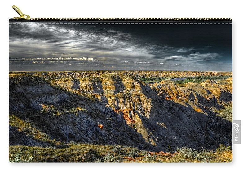 Badlands Carry-all Pouch featuring the photograph Badlands by Wayne Sherriff