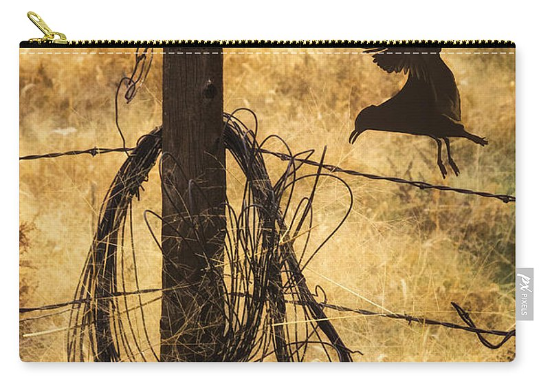 Barbed Landing Carry-all Pouch featuring the photograph Barbed Landing by Priscilla Burgers
