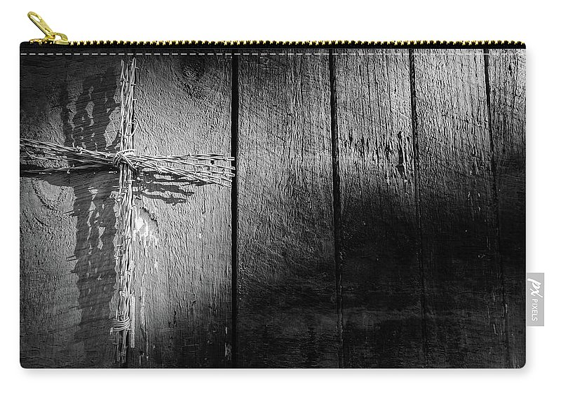 Architecture Carry-all Pouch featuring the photograph Barbed Wire Cross by Jim Love
