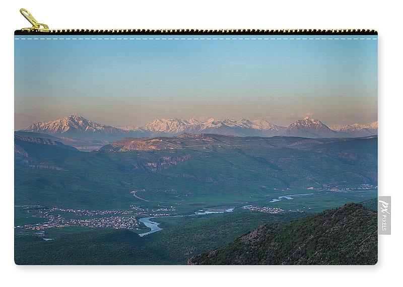 Barzan Carry-all Pouch featuring the photograph Barzan by Adam Mirani