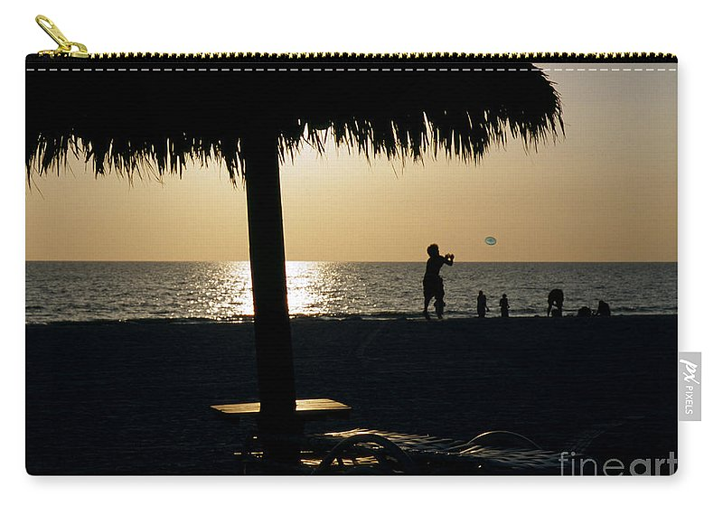 Beach Carry-all Pouch featuring the photograph Beach Frisbee At Sunset On Marco Island Florida by William Kuta