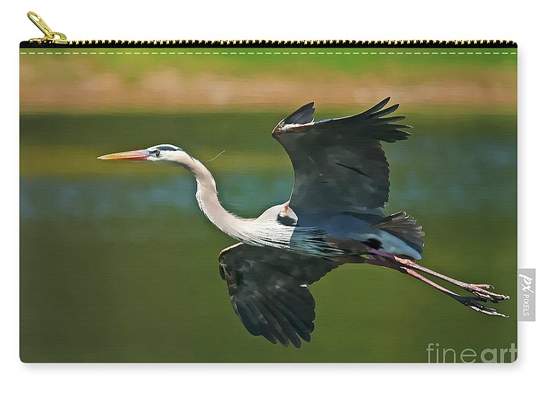 Blue Heron Carry-all Pouch featuring the photograph Beauty In Flight by Deborah Benoit