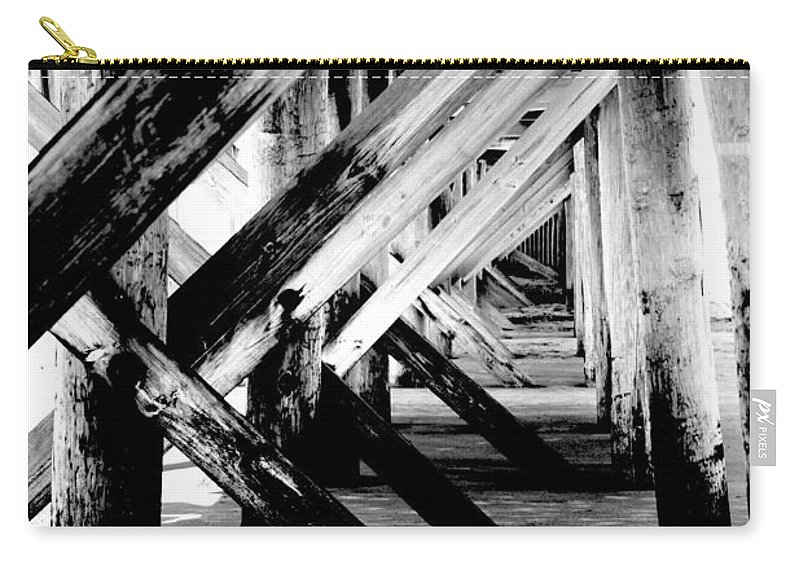 Black Carry-all Pouch featuring the photograph Beneath The Docks Night by Jamie Lynn