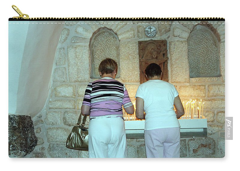Bethlehem Carry-all Pouch featuring the photograph Bethlehem - Milk Grotto Church Lighting Candles by Munir Alawi