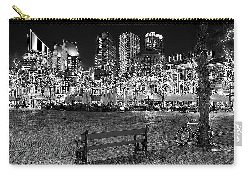 The Hague Carry-all Pouch featuring the photograph Bicycle On The Plein At Night - The Hague by Barry O Carroll