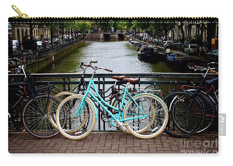 Bicycle Carry-all Pouch featuring the photograph Bicycle Parked At The Bridge In Amsterdam. Netherlands. Europe by Bernard Jaubert