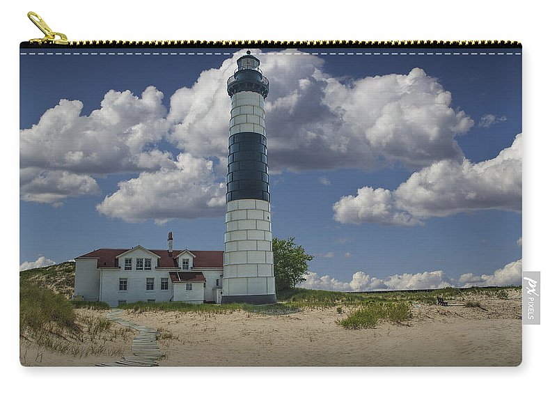 Michigan Carry-all Pouch featuring the photograph Big Sable Lighthouse Under Cloudy Blue Skies by Randall Nyhof