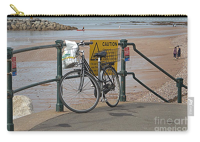 Bike Carry-all Pouch featuring the photograph Bike against Railings by Andy Thompson