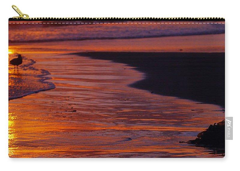 Beach Ocean Bird Sunset Orange Waves Carry-all Pouch featuring the photograph Bird At Sunset by Jill Reger