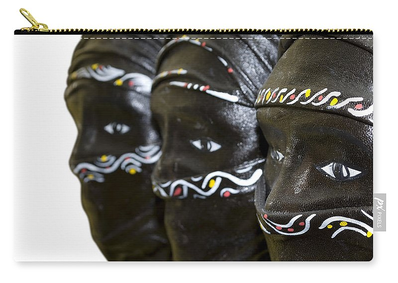 Black Carry-all Pouch featuring the photograph Black Masks by Svetlana Sewell