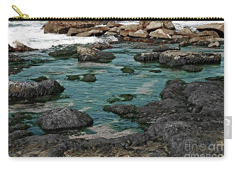 Seascape Carry-all Pouch featuring the photograph Black Rocks On Blue Water by Idan Badishi