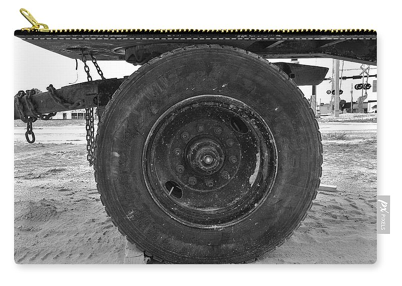 Black And White Carry-all Pouch featuring the photograph Black Wheel by Rob Hans