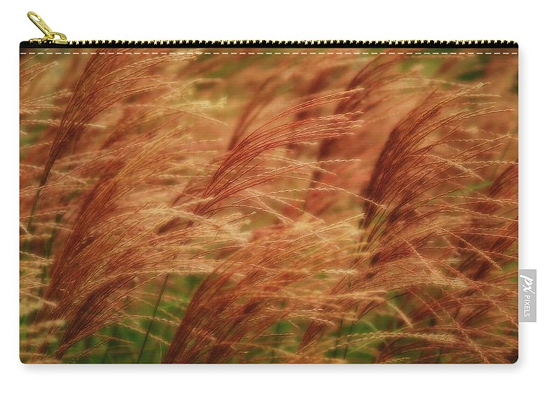 Win Carry-all Pouch featuring the photograph Blowing In The Wind by Gaby Swanson