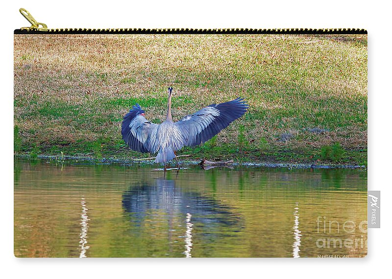 Blue Heron Carry-all Pouch featuring the photograph Blue On The Bank by Deborah Benoit