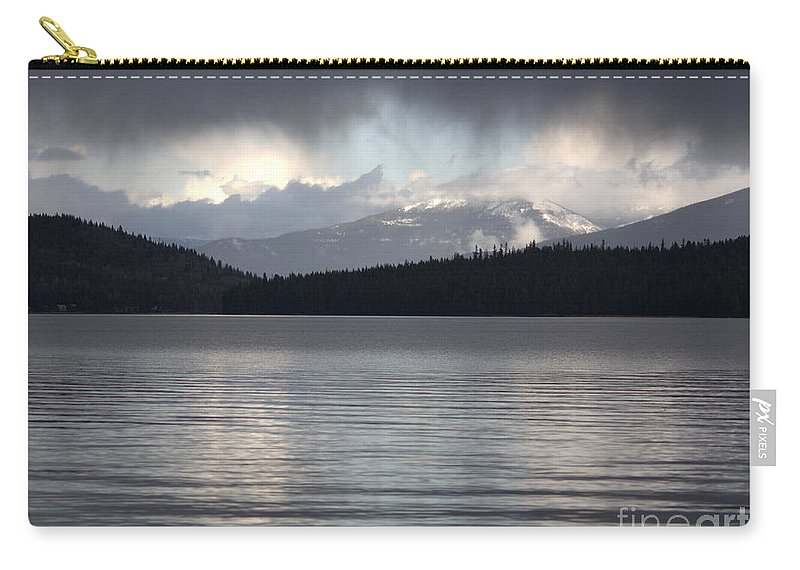 Clouds Carry-all Pouch featuring the photograph Blue Sky Through Dark Clouds by Carol Groenen
