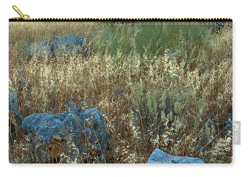 Iznajar Carry-all Pouch featuring the photograph blue stones amongst the olive groves near Iznajar Andalucia Spain by Mal Bray
