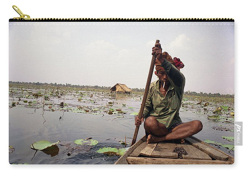 Cambodia Carry-all Pouch featuring the photograph Boatman - Battambang by Patrick Klauss