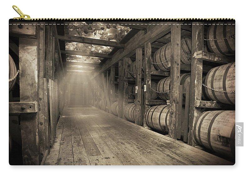 Bourbon Barrel Carry-all Pouch featuring the photograph Bourbon Barrels by Glass Glow by Karen Varnas