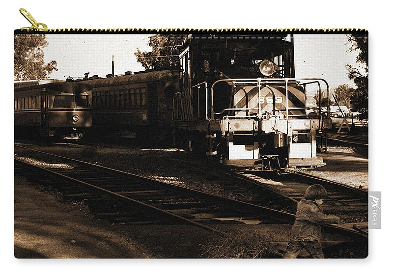Train Carry-all Pouch featuring the photograph Boy On The Tracks by Anthony Jones
