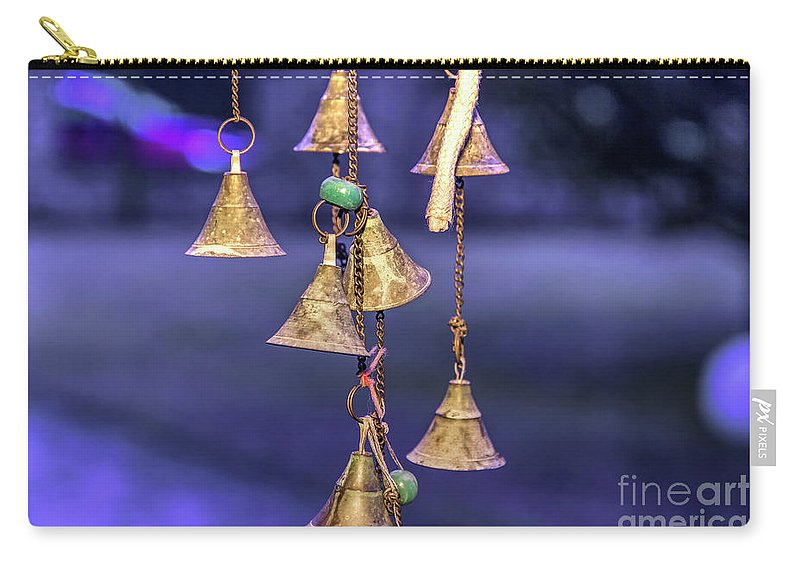 Objects Carry-all Pouch featuring the photograph Brass Bells Hanging In The Illuminated Courtyard At Winter Night by Bratislav Stefanovic