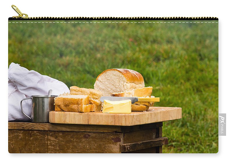 Food Photography Carry-all Pouch featuring the photograph Bread With Butter On Cutting Board by Jacek Wojnarowski