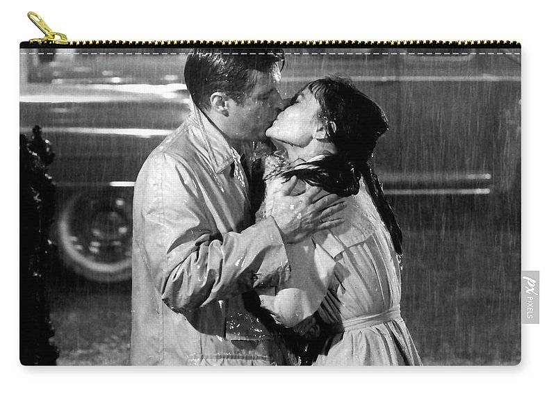 Paramount Carry-all Pouch featuring the photograph Breakfast At Tiffanys Audrey Hepburn And George Peppard by R Muirhead Art