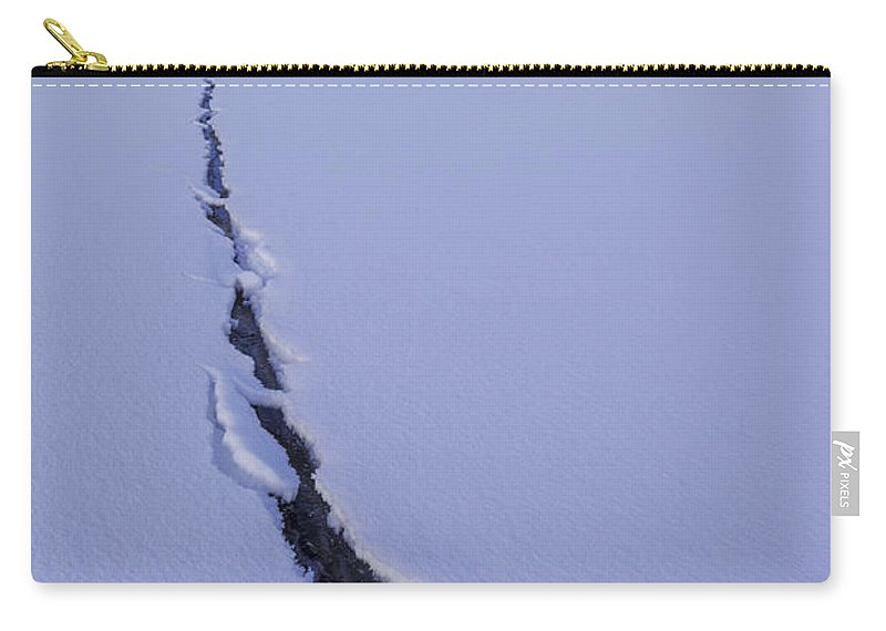 Breaking Ice Carry-all Pouch featuring the photograph Breaking Ice by Chad Dutson