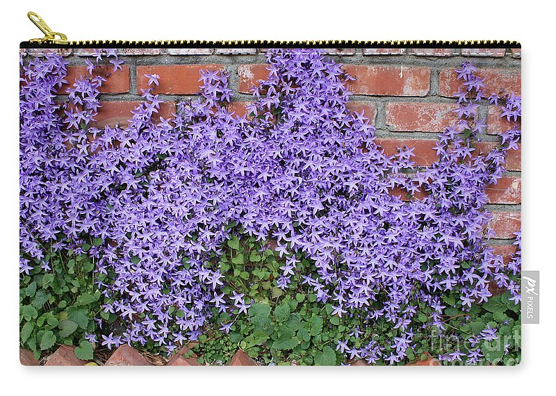 Blue Flowers Carry-all Pouch featuring the photograph Brick Wall With Blue Flowers by Carol Groenen