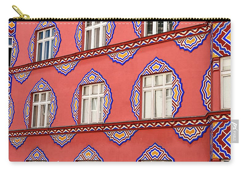 Cooperative Business Bank Carry-all Pouch featuring the photograph Brightly Colored Facade Of Cooperative Business Bank Building Or by Reimar Gaertner