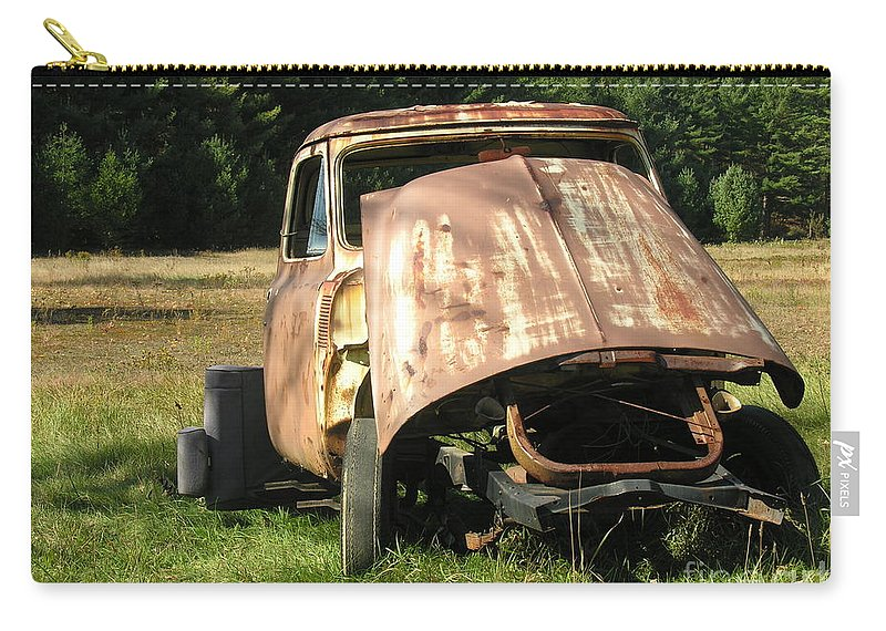 Broken Carry-all Pouch featuring the photograph Broken And Confused by Diane Greco-Lesser