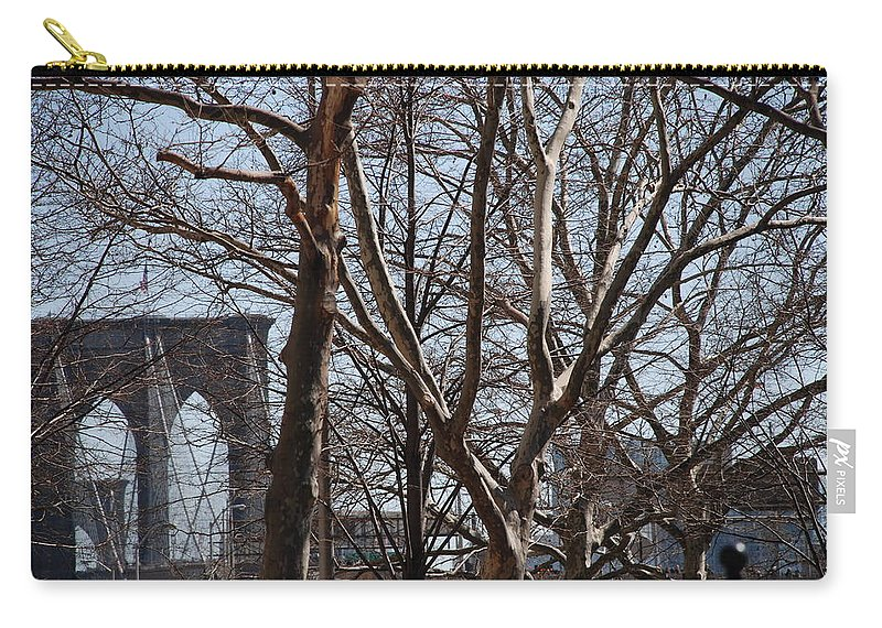 Architecture Carry-all Pouch featuring the photograph Brooklyn Bridge Thru The Trees by Rob Hans