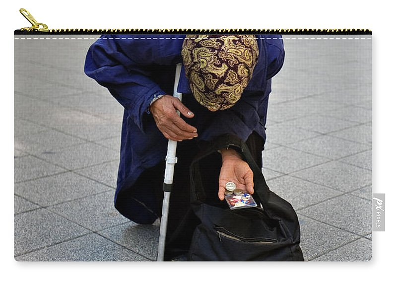 Woman Carry-all Pouch featuring the photograph Budapest Beggar by Madeline Ellis