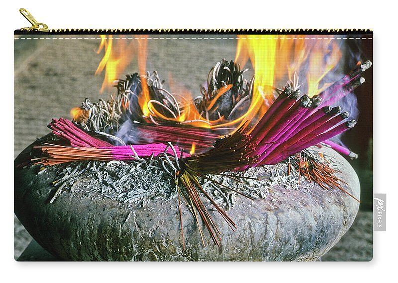 China Carry-all Pouch featuring the photograph Burning Joss Sticks by Michele Burgess