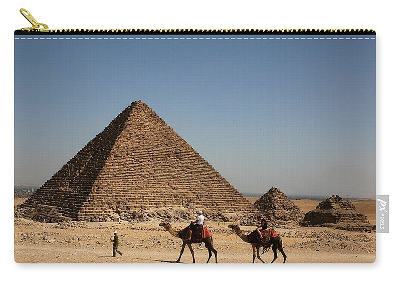 Camels Carry-all Pouch featuring the photograph Camel Ride At The Pyramids by Donna Corless