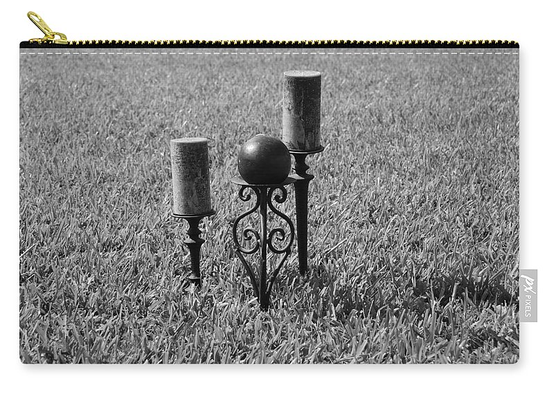 Black And White Carry-all Pouch featuring the photograph Candles In Grass by Rob Hans
