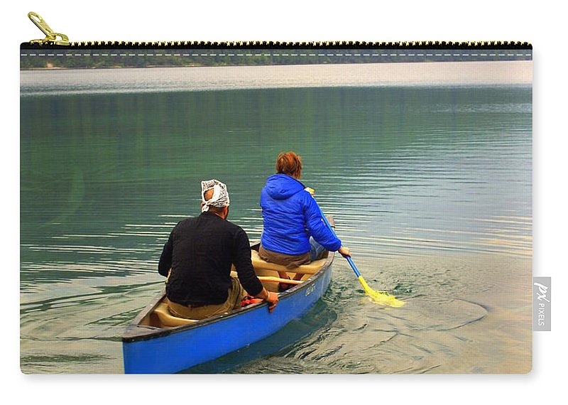 Glacier National Park Carry-all Pouch featuring the photograph Canoeing Glacier Park by Marty Koch