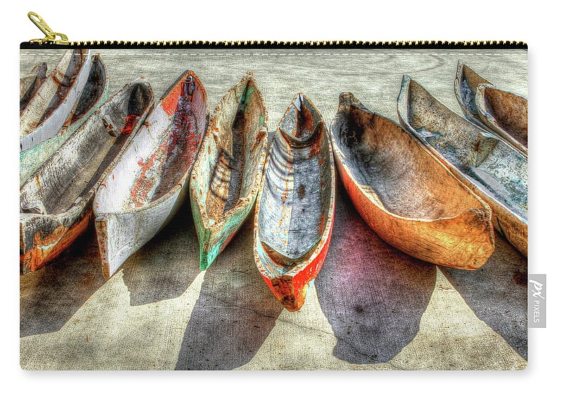 The Carry-all Pouch featuring the photograph Canoes by Debra and Dave Vanderlaan