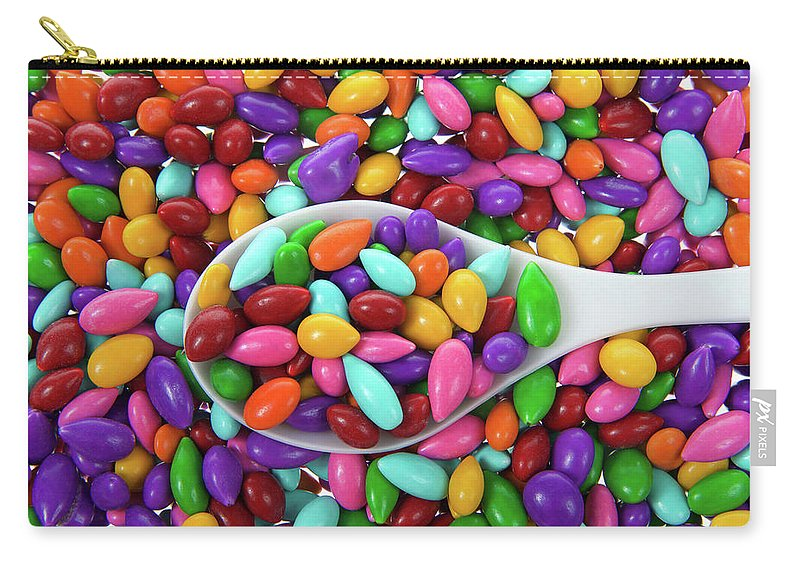 Coated Carry-all Pouch featuring the photograph Candy Covered Sunflower Seeds by Sheila Fitzgerald