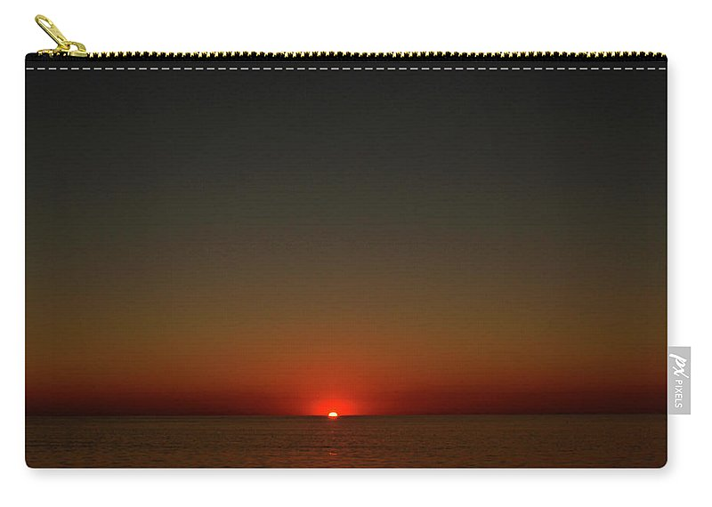 Carry-all Pouch featuring the photograph Cape Cod Sun Drop by Garrett Sheehan