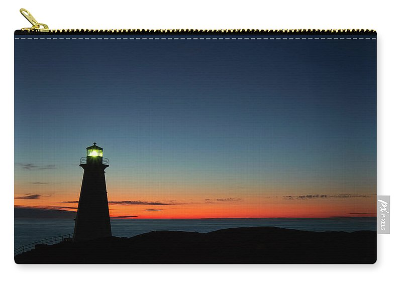 Canada Carry-all Pouch featuring the photograph Cape Spear Sunrise by Linda Cullivan