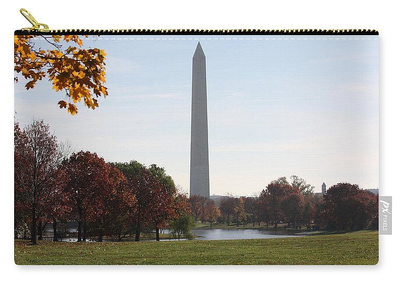 Capital Carry-all Pouch featuring the photograph Capital Autumns - The Washington Monument - Under The Trees by Ronald Reid