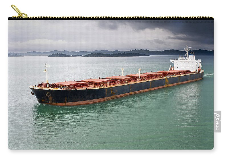 Central America Carry-all Pouch featuring the photograph Cargo Ship Under Stormy Sky by John Trax