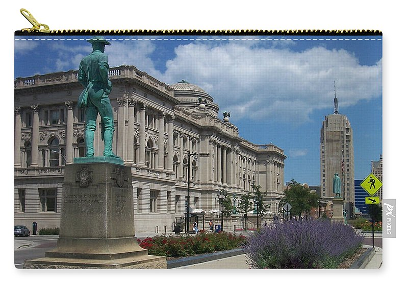 Central Library Carry-all Pouch featuring the photograph Central Library Milwaukee Street View by Anita Burgermeister