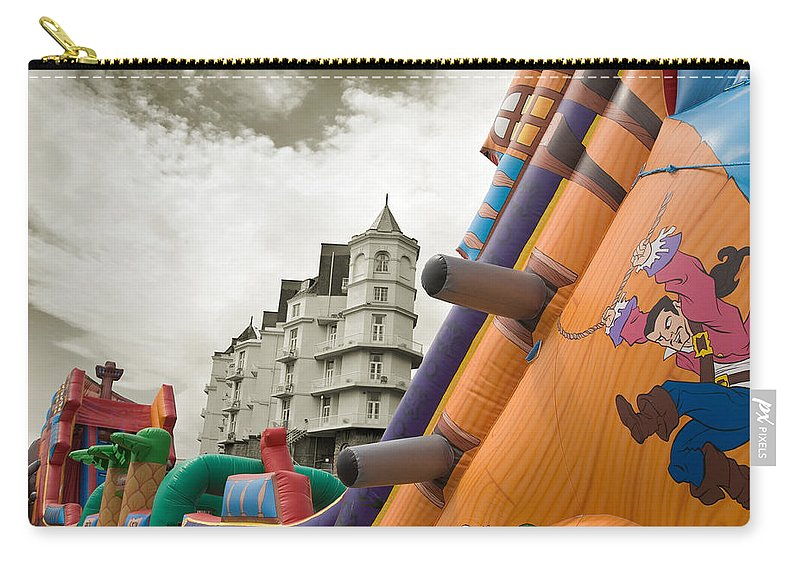 Childrens Carry-all Pouch featuring the photograph Childrens Play Areas Contrast With The Victorian Elegance Of The Grand Hotel In Llandudno Wales Uk by Mal Bray
