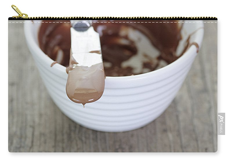 Chocolate Carry-all Pouch featuring the photograph Chocolate Sauce In Bowl by Neil Overy