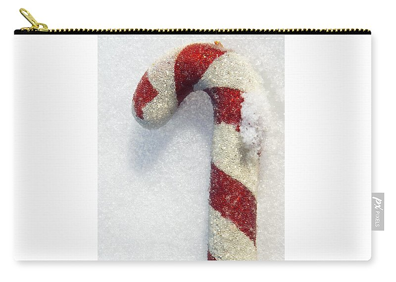 Christmas Carry-all Pouch featuring the photograph Christmas Candy Cane On Real Snow by Isabelle Haynes