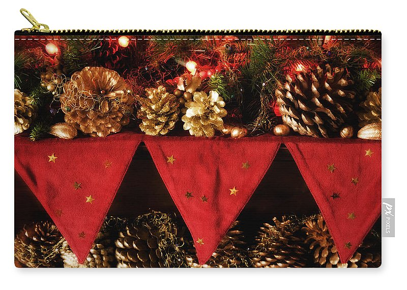 Christmas Carry-all Pouch featuring the photograph Christmas Decorations Of Garlands And Pine Cones by Mal Bray
