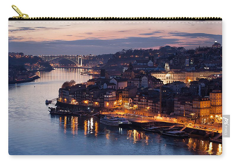 Porto Carry-all Pouch featuring the photograph City Of Porto In Portugal At Dusk by Artur Bogacki